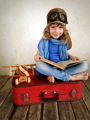 Child dreaming about travel